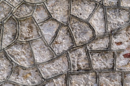 grey pattern: cellular texture of a cement or concrete covering of a stone surface for an abstract background
