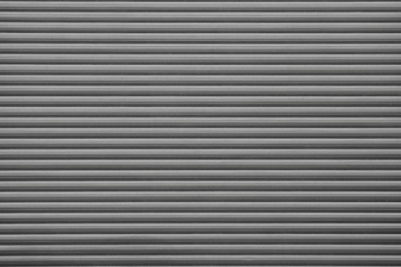 grooved: abstract grooved texture of blinds for backgrounds of black color with a blank space for the text