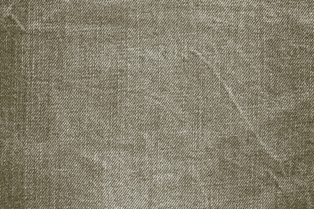 wornout: abstract texture of old worn-out denim of dirty color for backgrounds and for wallpaper