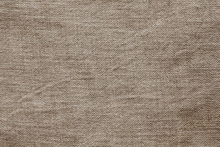 wornout: abstract texture of old worn-out denim of brown color for backgrounds and for wallpaper Stock Photo