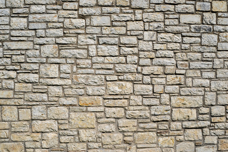 channeled: old wall from a stone brick for the abstract textured backgrounds and for wallpaper