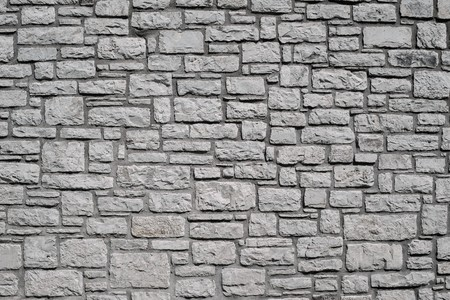channeled: old wall from a stone brick of gray color for the abstract textured backgrounds and for wallpaper