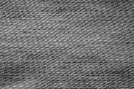 wornout: abstract texture of old worn-out denim of black color for backgrounds and for wallpaper