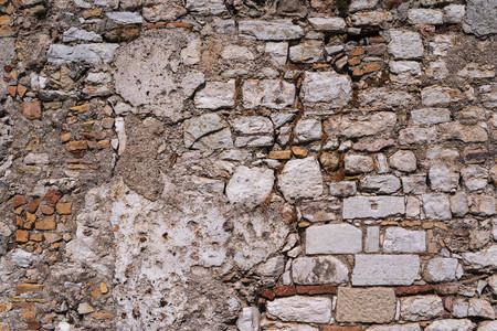 blasted: vintage background old abstract texture of the destroyed stone wall or ancient ruins