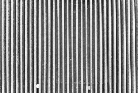 channeled: channeled texture of a water drain lattice for backgrounds and for wallpaper