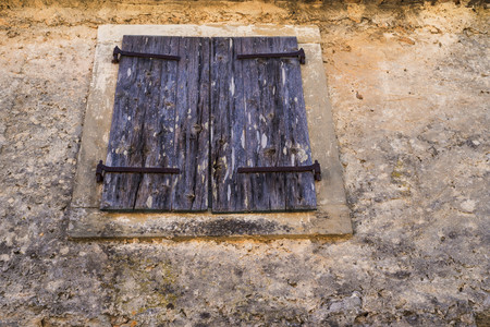 worn structure: the textured design of an old closed wooden shutter or blinds for an abstract architectural background Stock Photo