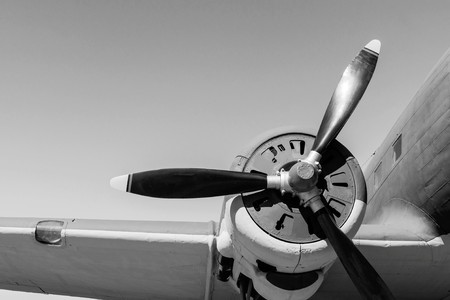 part of a retro of the plane with the propeller closeup in monochrome tones and a place for the text in the sky