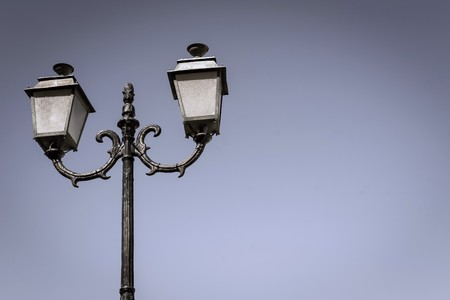 plafond: the isolated ancient lamp on an iron column against the sky
