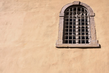 lattice window: part old facade of the house with one window with an iron lattice and a blank space for the text