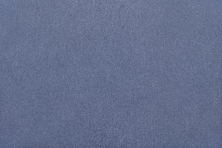 speckle: abstract texture of fabric or textile material of dark blue color for the textured background and for wallpaper