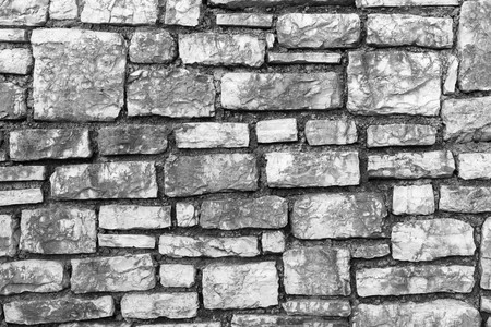 channeled: the rough channeled textured surface of a stone wall for a vintage background or for wallpaper