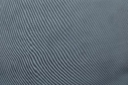 silvery: the abstract textured background from textile material or from fabric of silvery monochrome color with design grained of texture