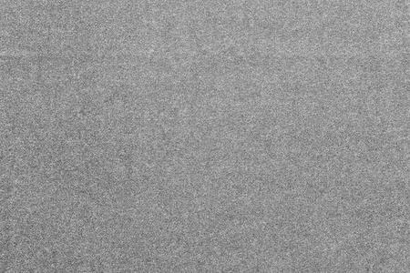 textile texture: the abstract monochrome textured background from fabric or from textile material of gray color with speckled of design texture and with fibers Stock Photo