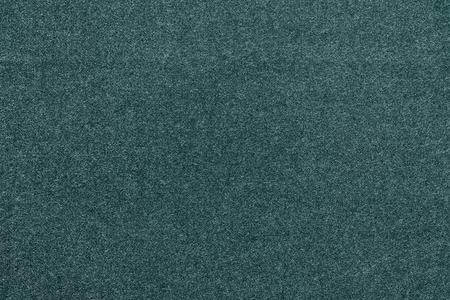 speckle: the abstract monochrome textured background from fabric or from textile material of dark blue green color with speckled of design texture and with fibers