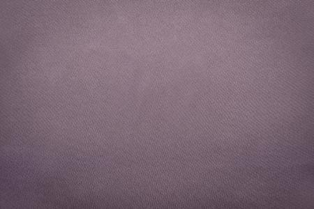 background material: the abstract textured background from textile material or from fabric of lilac gray monochrome color with design grained of texture