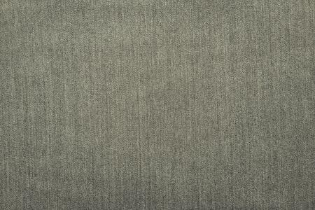 pale color: rough corrugated texture of denim material or cotton fabric for a monochrome background of pale color