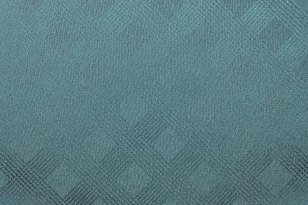 granular: granular texture of fabric or textile material of dark turquoise color or indigo with pattern checkered Stock Photo