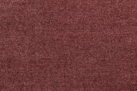 grained: rough grained texture of fabric or cotton material of red color for the textured textile background