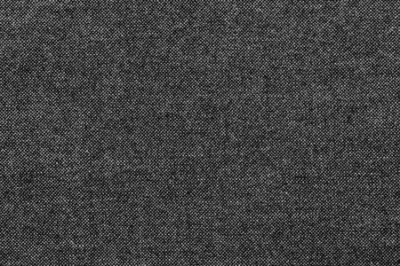 grained: rough grained texture of fabric or cotton material of black color for the textured textile background