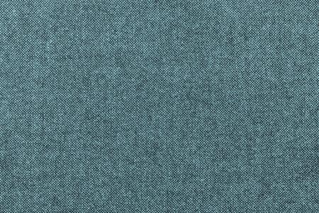 grained: rough grained texture of fabric or cotton material of indigo color for the textured textile background