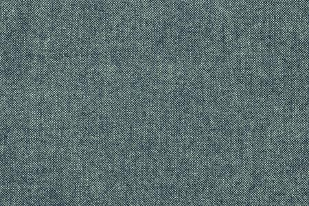 grained: rough grained texture of fabric or cotton material of green color for the textured textile background