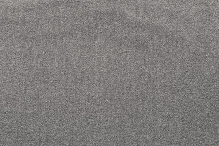 pale colour: the coarse textured abstract background from textile fabric of pale beige color