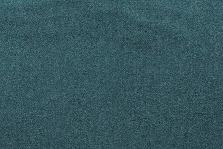 scabrous: the scabrous textured abstract background from textile fabric of dark indigo color
