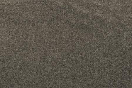 scabrous: the scabrous textured abstract background from textile fabric of dark beige color Stock Photo