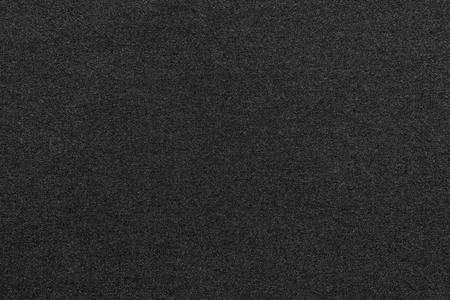 scabrous: the scabrous textured abstract background from textile fabric of black color