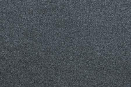 scabrous: the scabrous textured abstract background from textile fabric of dark silvery color