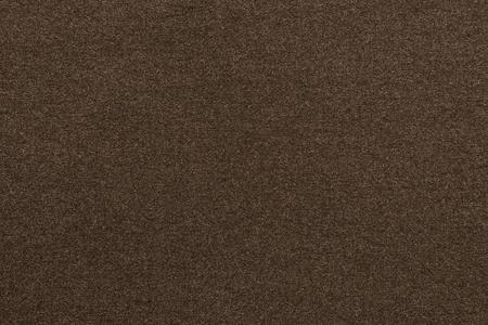 scabrous: the scabrous textured abstract background from textile fabric of dark brown color Stock Photo