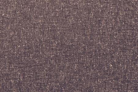 spotty: rough texture of speckled or spotty fabric of pale chocolate color for abstract textured textile background or for wallpaper