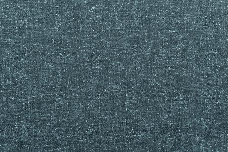 spotty: rough texture of speckled or spotty fabric of indigo color for abstract textured textile background or for wallpaper Stock Photo