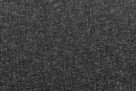 spotty: rough texture of speckled or spotty fabric of black color for abstract textured textile background or for wallpaper