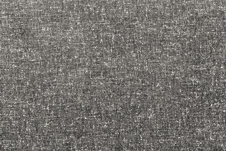 textile: abstract speckled texture of dense fabric of beige color for textile backgrounds or for wallpaper Stock Photo
