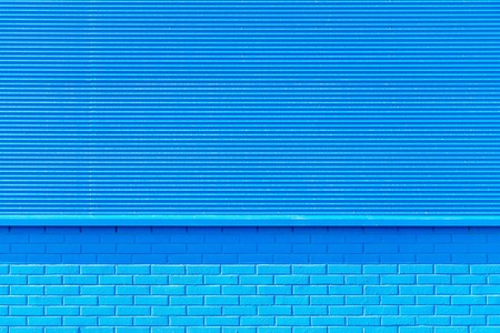 blank space: the textured background from corrugated iron and a brick of blue color and a blank space for the text Stock Photo