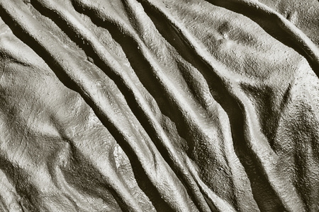 concave: the abstract textured convex or concave bumpy background of graphite color Stock Photo