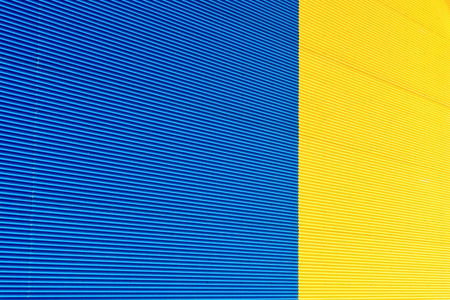 channeled: the textured background from corrugated iron of yellow and blue color and a blank space for the text