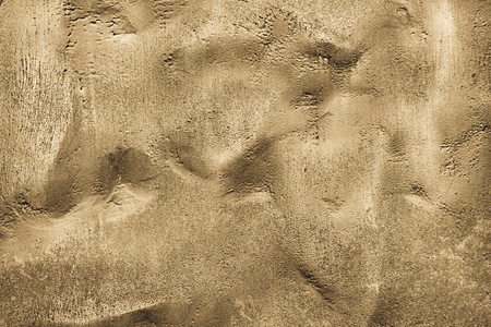bumpy: the abstract textured background of a bumpy surface of bronze sand color Stock Photo