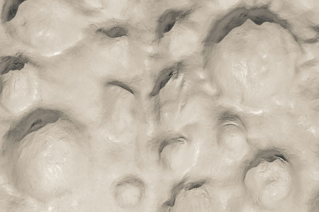 bumpy: the abstract textured background of a bumpy surface of beige color