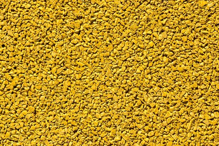 grained: the abstract textured grained background of yellow sand color