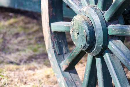 spokes: fragment of a big wooden wheel with spokes for an ancient cartage and for the cart or the vehicle