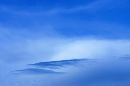 singly: the blue cloudy sky with a separate cloud of an abstract form for a natural background
