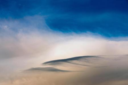 singly: the blue pink cloudy sky with a separate cloud of an abstract form for a natural background