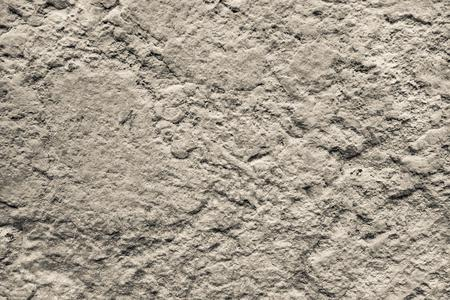 bumpy: bumpy texture of a concrete or stone surface of beige color for abstract background and for wallpaper
