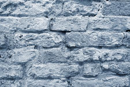 the silvery: the old textured surface of a silvery brick wall for wallpaper and for a background Stock Photo