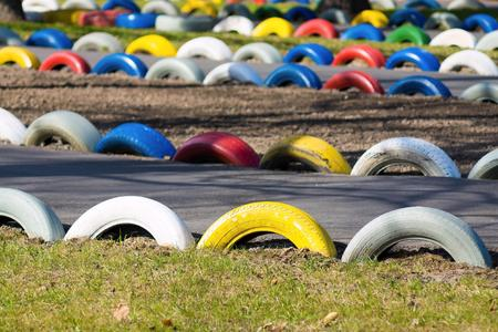 buffer: attraction in an amusement park the autodrome for a auto buggy with a buffer protection from old tire covers