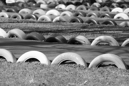 damper: attraction in an amusement park the autodrome for a auto buggy with a buffer protection from old tire covers