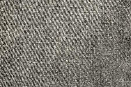 speckle: the textured background from rough cotton material or denim of pale beige color Stock Photo