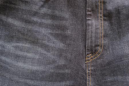 threadbare: fragment closeup of threadbare trousers from jeans material or jeans clothes with a codpiece for the textile textured background